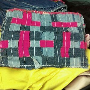Upcycled braided Jean clutch